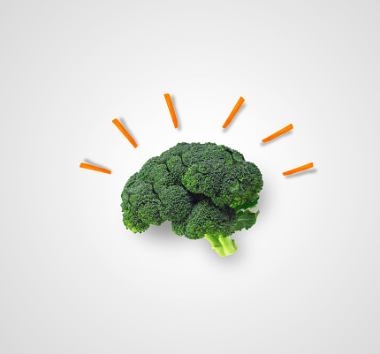 A broccoli shaped like a brain with carrots coming off of it