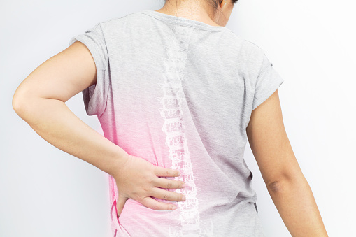 Person suffering with spinal pain