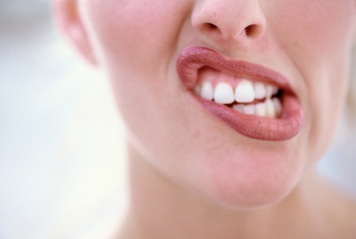 A woman making a funny shape with her mouth