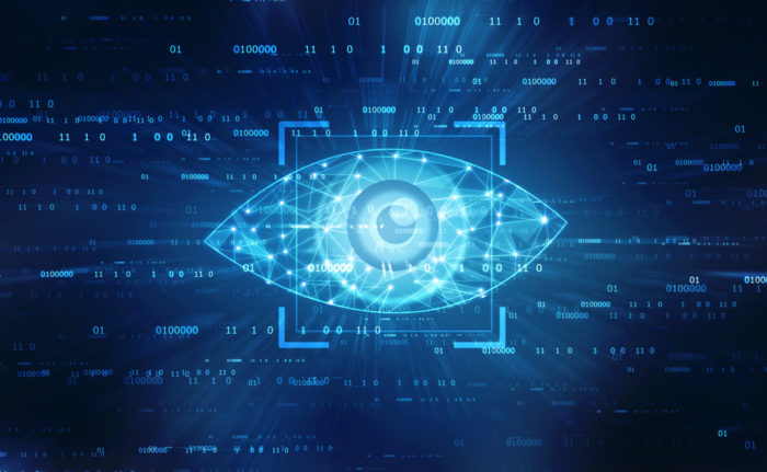 A blue geometric eye with computer coding in the background
