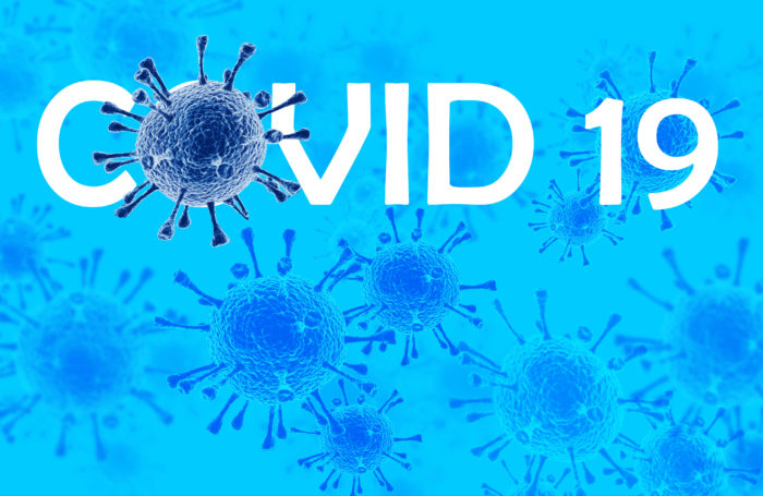 COVID-19 text surrounded by blue Coronavirus cells