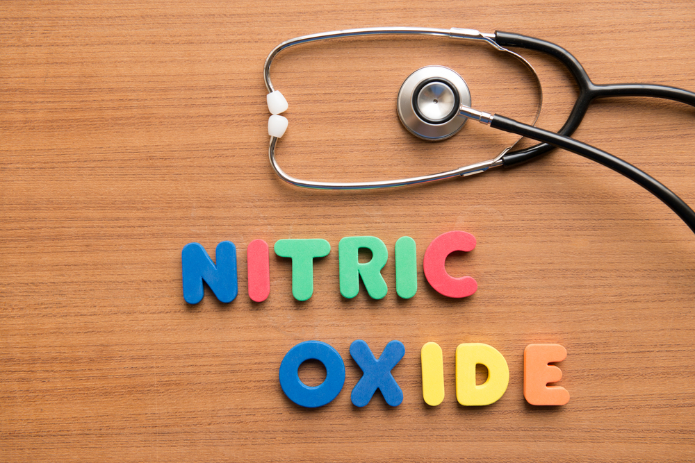 Nitric Oxide spelled out in fridge magnets next to a stethoscope
