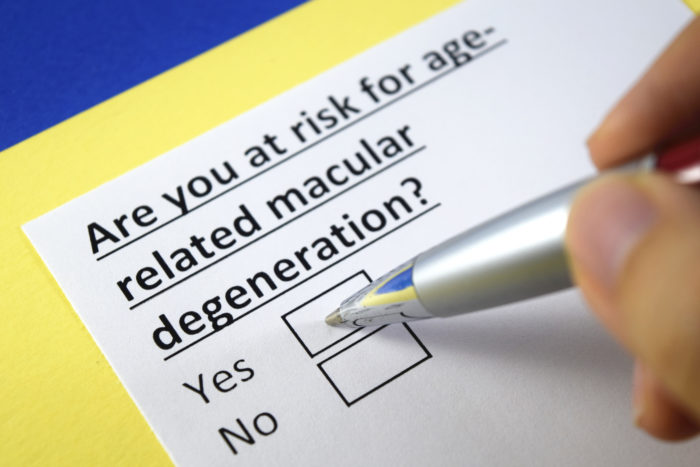 A pen on a box ticking yes to the question 'Are you at risk for age-related macular degeneration?'