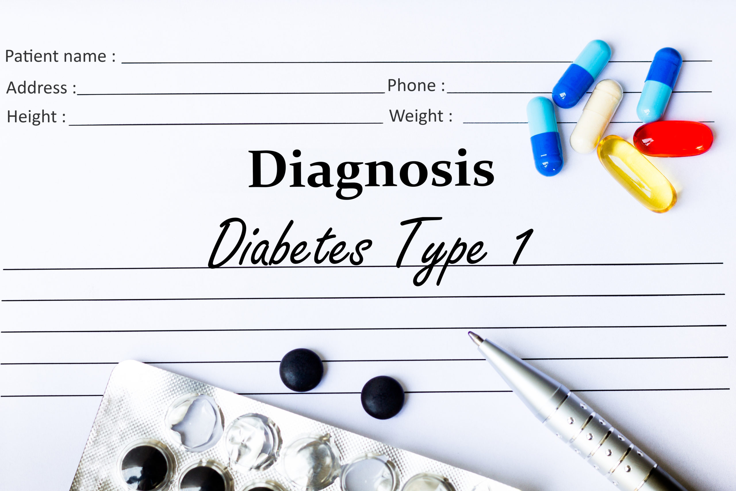Diabetes Type 1 Diagnosis written down on paper surrounded by pills
